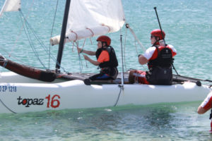 boy and instructor sailing