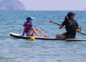 Mum and child paddleboard