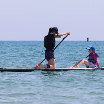 Mum and child paddleboard