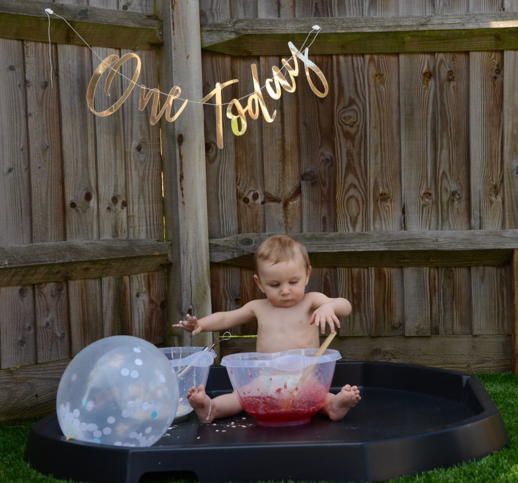 Baby outdoor messy play