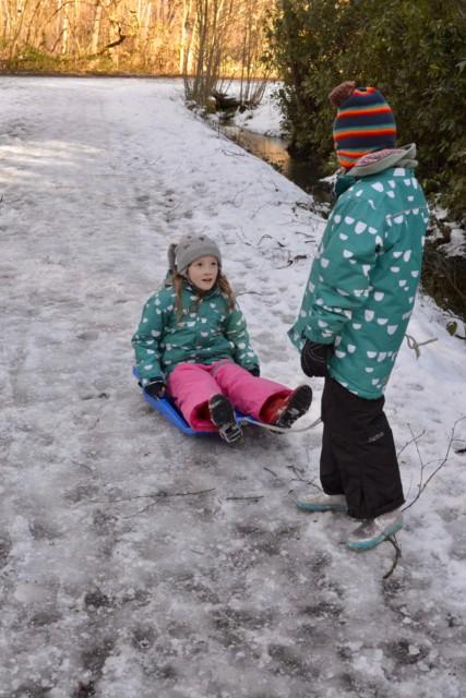 Child pulling a sledge