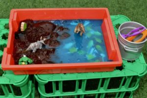 Dinosaur jelly play in a gratnells container