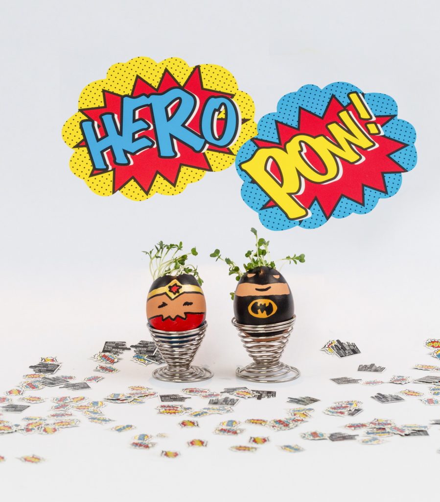 cress grown in eggshells decorated like superheroes