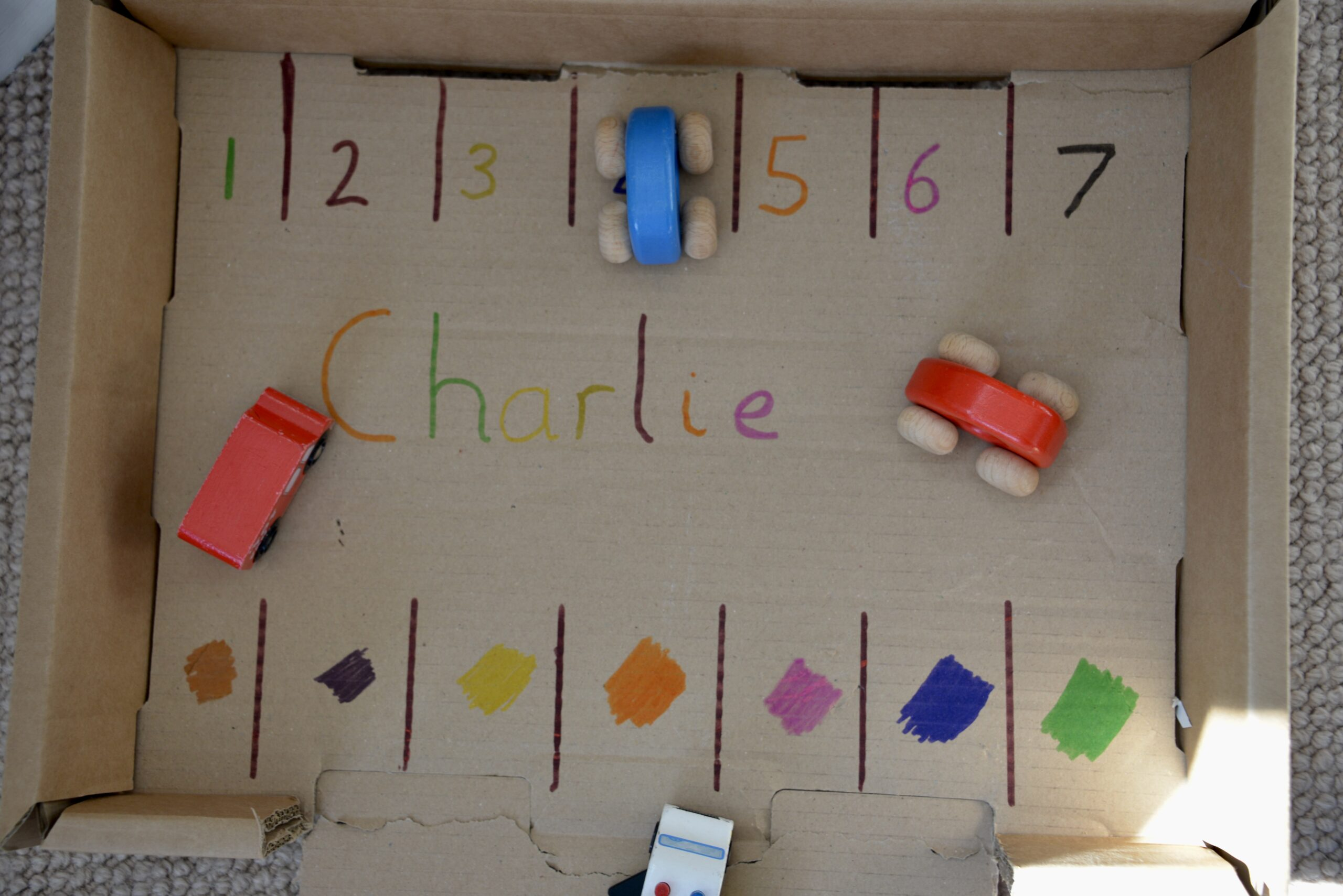 recycled cardboard box car park used to teach numbers and colours