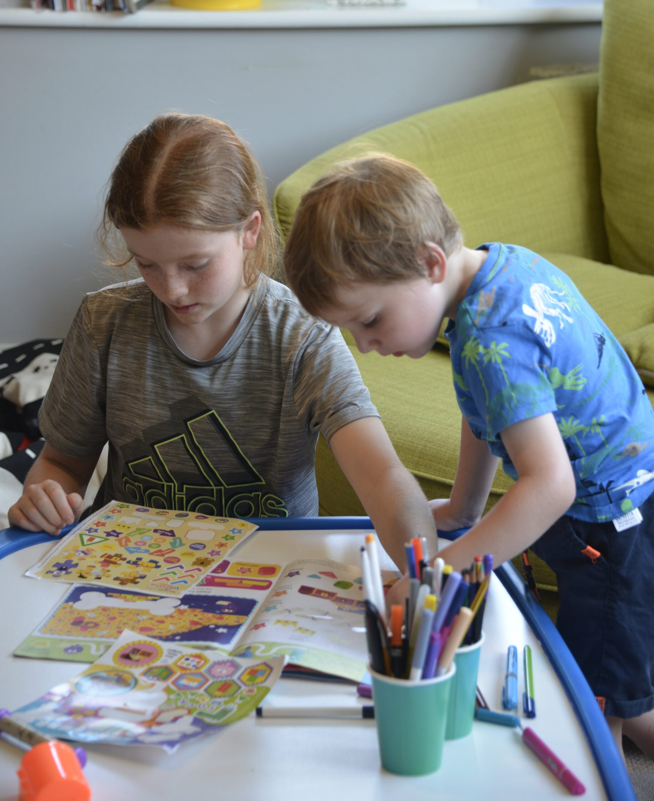Two children working on the Hey Duggee magazine
