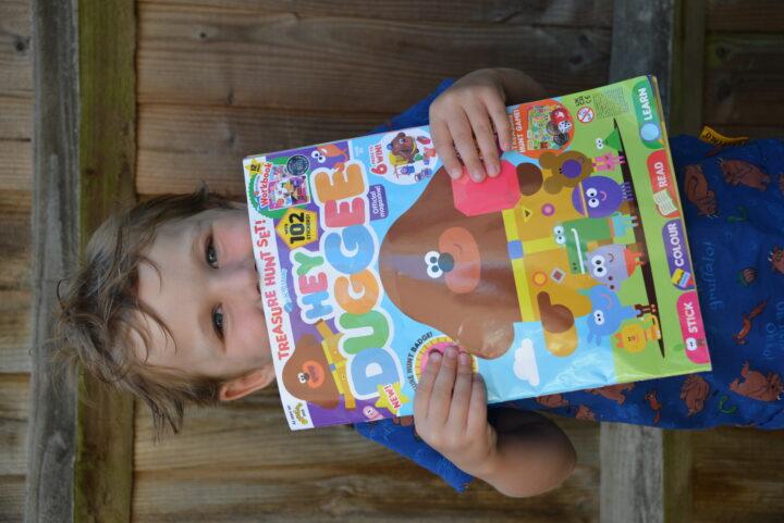 Little boy holding the Hey Duggee Magazine