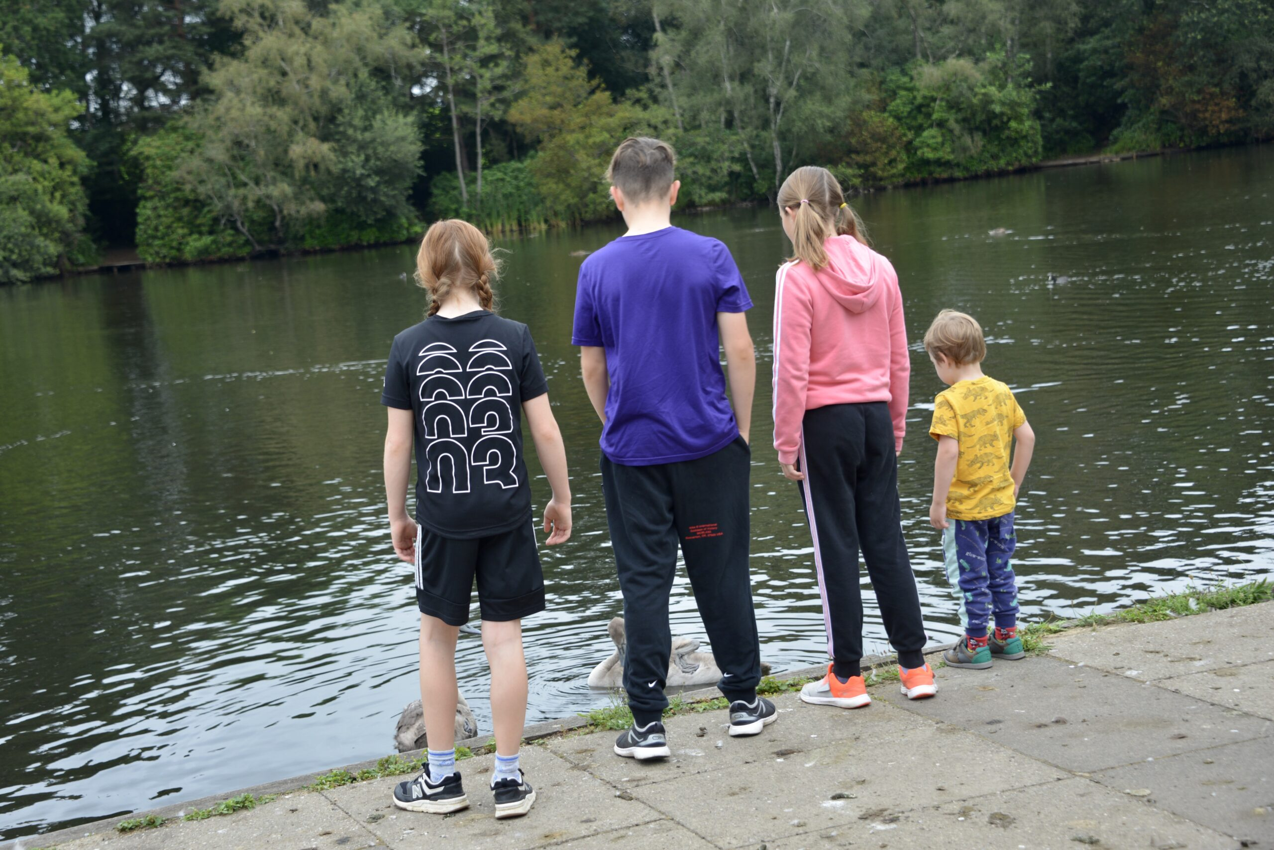 4 children looking out into a lake