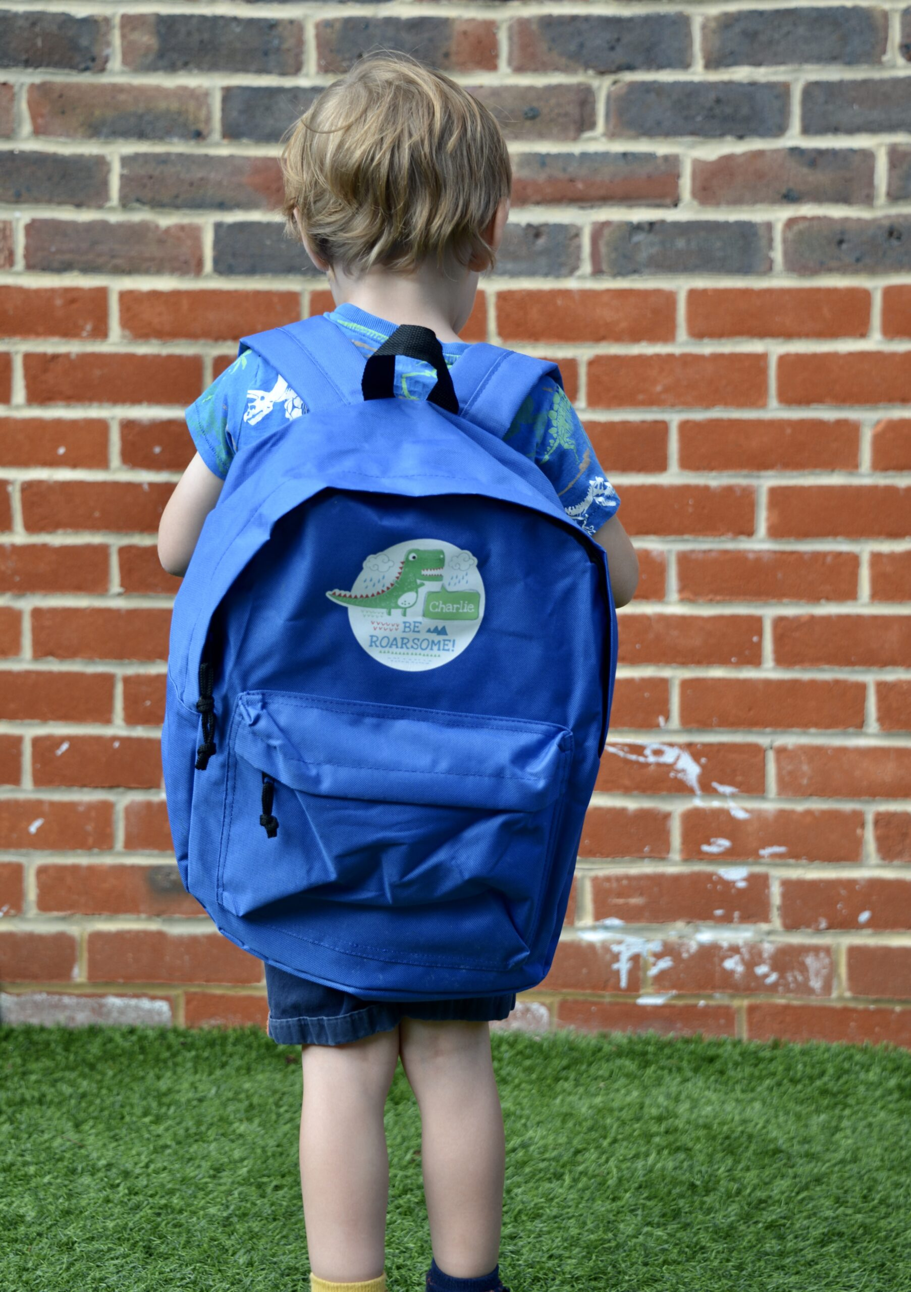 boy with a personalised backpack on his bag
