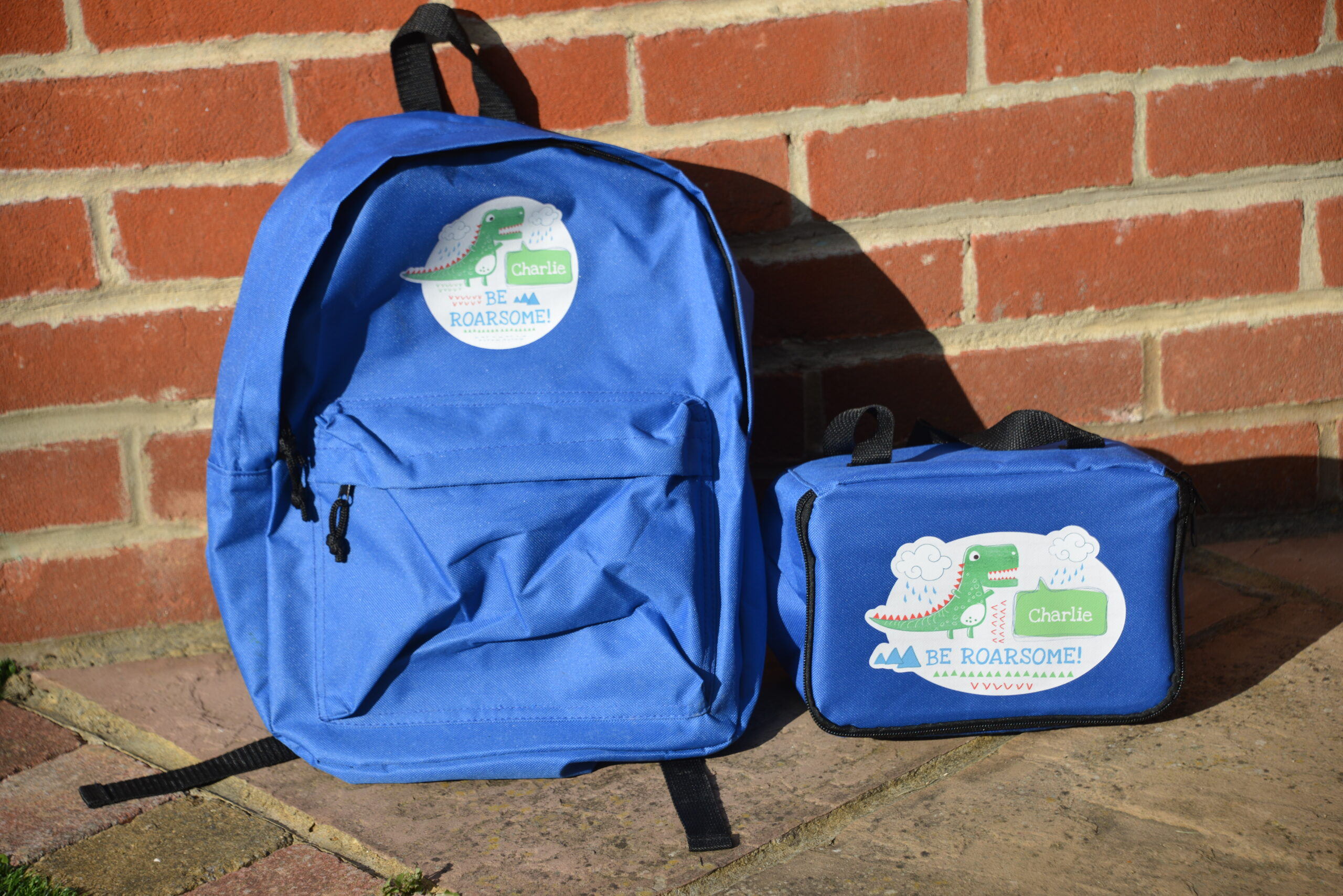 blue personalised dinosaur backpack and lunch bag