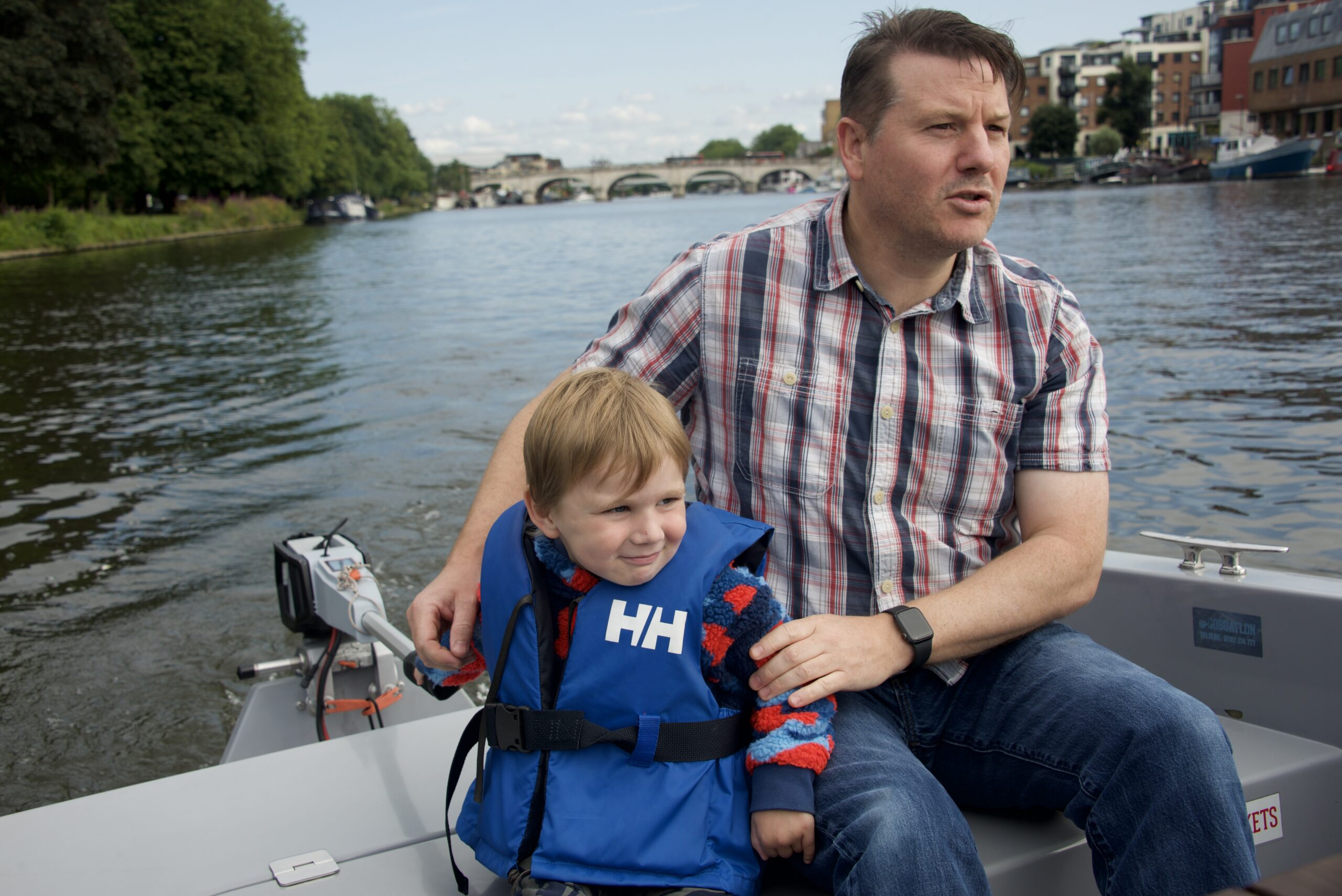 Dad and child on a goBoat adventure down the Thames