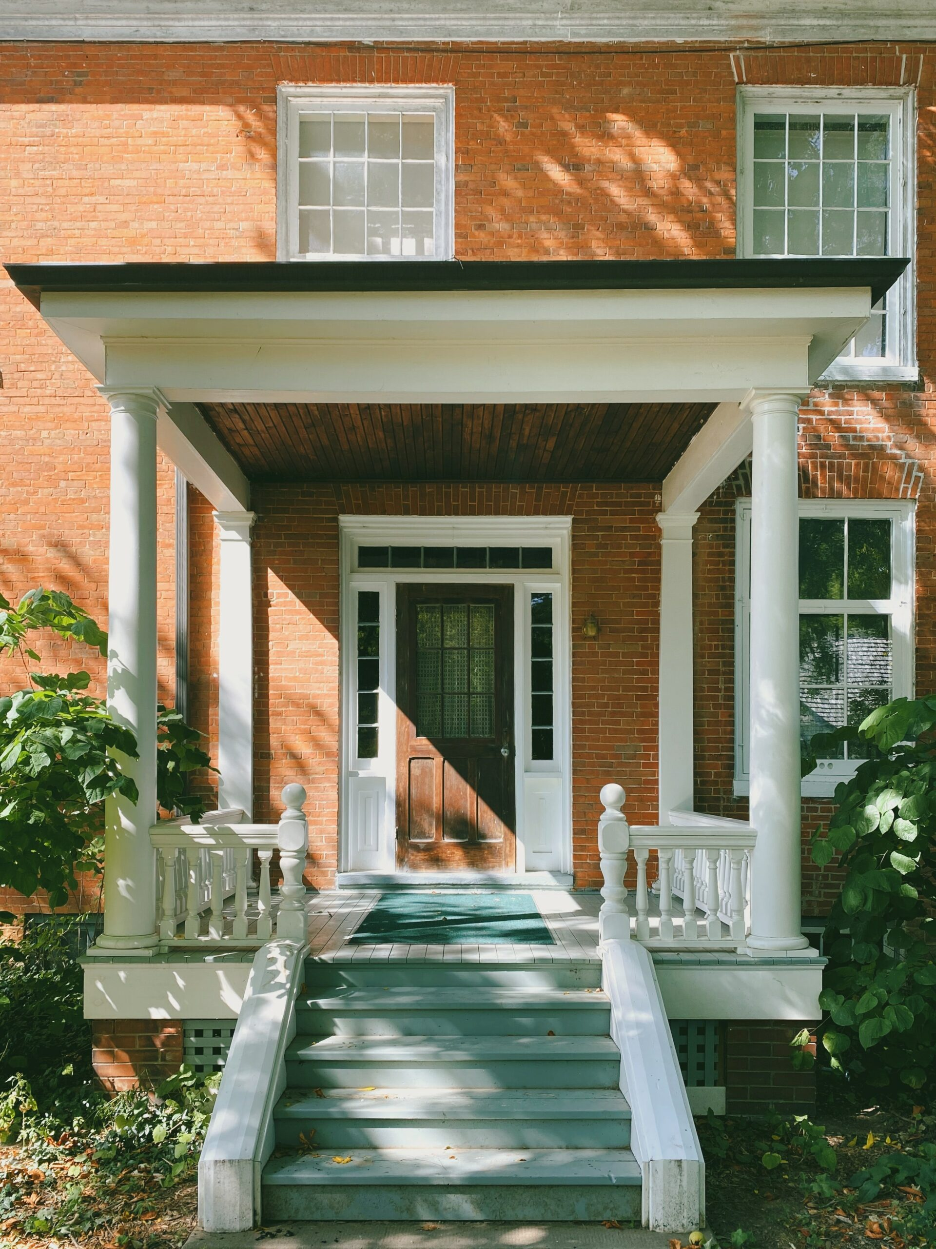 Image of a front door with a large porch